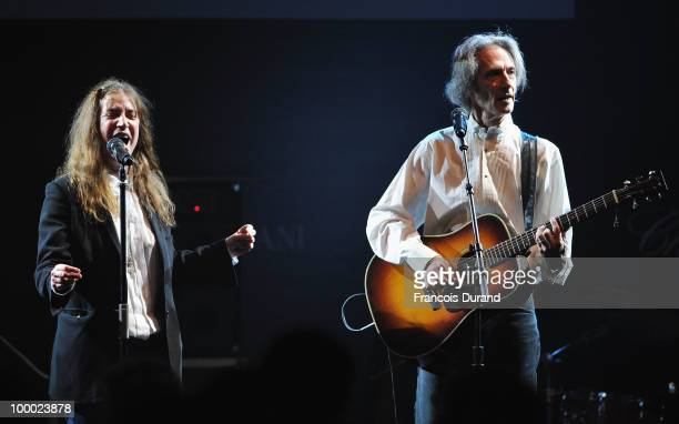 Patti Smith and Lenny Kaye perform during amfAR's Cinema Against AIDS 2010 benefit gala at the Hotel du Cap on May 20 2010 in Antibes France