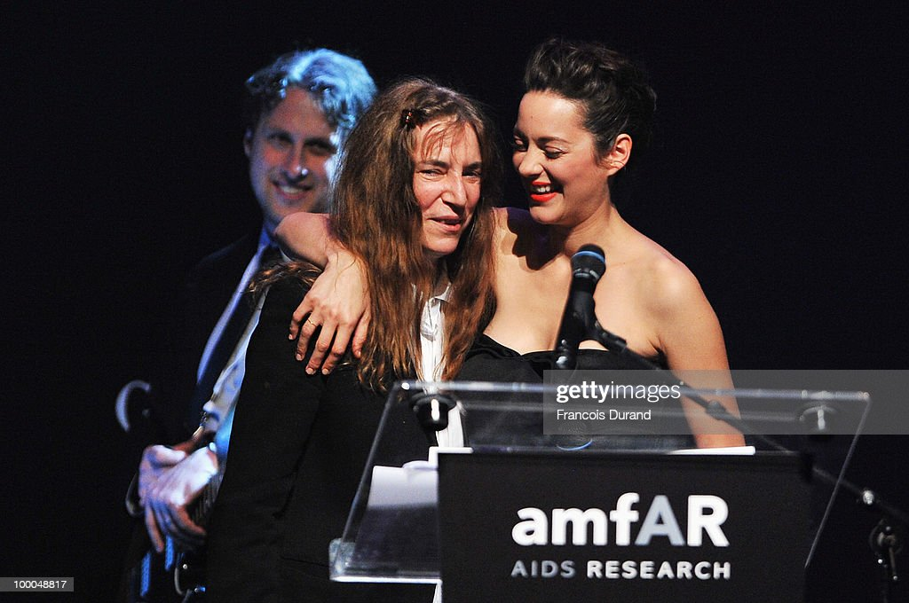 Patti Smith and Marion Cotillard speak during amfAR's Cinema Against AIDS 2010 benefit gala at the Hotel du Cap on May 20, 2010 in Antibes, France.