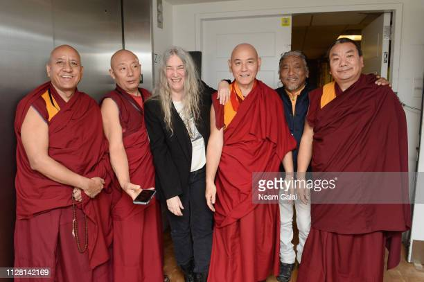 Patti Smith and monks pose backstage during the 32nd Annual Tibet House US Benefit Concert Gala at Carnegie Hall on February 07 2019 in New York City