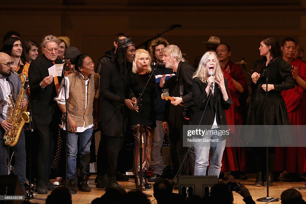 Patti Smith (C) and musicians perform on stage at the Tibet House Benefit Concert 2015 at Carnegie Hall on March 5, 2015 in New York City.