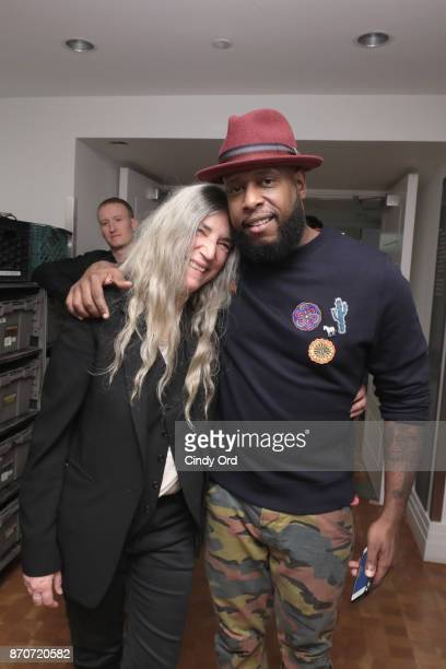 Patti Smith and Talib Kweli are seen backstage during Pathway To Paris Concert For Climate Action at Carnegie Hall on November 5 2017 in New York City
