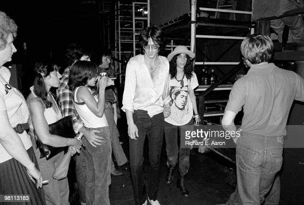 Patti Smith backstage with Lenny Kaye from The Patti Smith Group in Central Park as part of The Dr Pepper Music Festival on August 04 1978