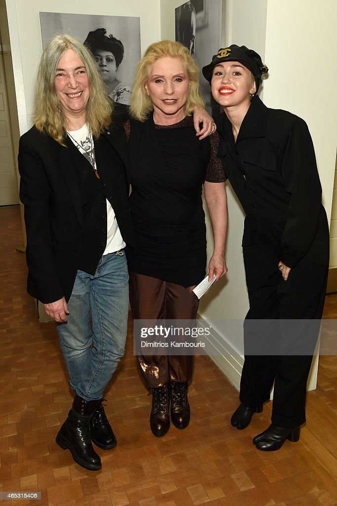Patti Smith, Debbie Harry and Miley Cyrus pose backstage Carnegie Hall the Tibet House Benefit Concert 2015 on March 5, 2015 in New York City.