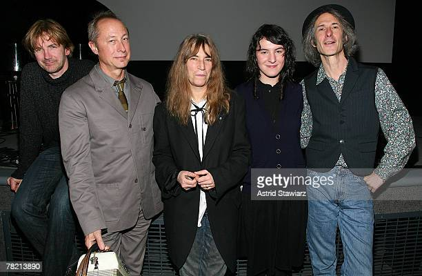 Patti Smith Group band members Tony Shanahan Jay Dee Daugherty Patti Smith Jesse Smith and Lenny Kaye pose for photos after their performance at the...