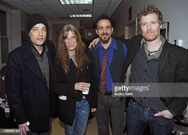 Patti Smith Jakob Dylan Rich Pagano and Glen Hansard at rehearsals for The Music of Neil Young at Carnegie Hall on February 10 2011 in New York City