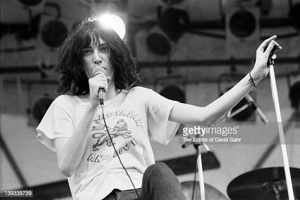 Patti Smith of The Patti Smith Group performs on July 9 1976 at the Shaefer Music Festival in Central Park in New York City New York