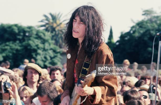 Patti Smith performs in the parking lot of the Sunset Bvd Licorice Pizza record store on May 11 1978 in Los Angeles California