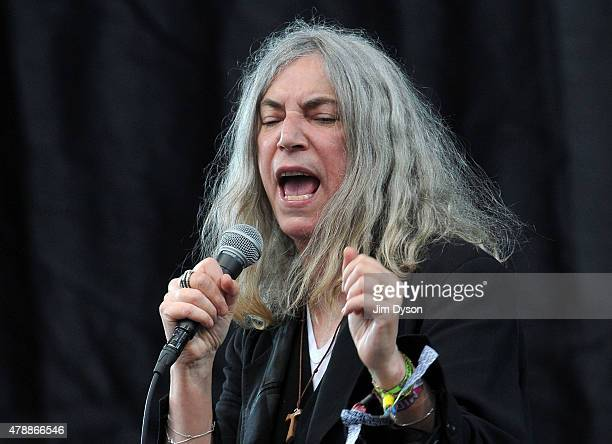 Patti Smith performs live on the Pyramid stage during the third day of Glastonbury Festival at Worthy Farm Pilton on June 28 2015 in Glastonbury...