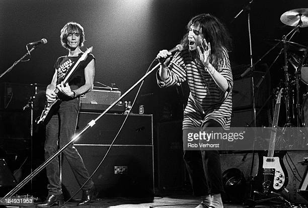 Patti Smith performs on stage with Ivan Kral behind at Jaap Eden Hal Amsterdam Netherlands 4th September 1979