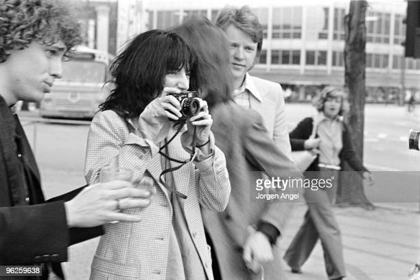 Patti Smith poses for a portrait with Richard Sohl taking pictures with her Leica camera in May 1976 in Copenhagen Denmark