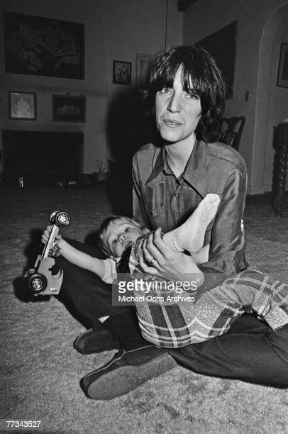 Patti Smith poses with a friend's child in November 1974 in Los Angeles California