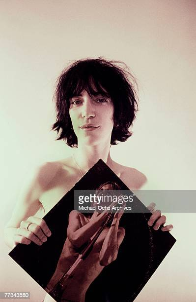 Patti Smith poses with an Iggy Pop album in November 1974 in Los Angeles California
