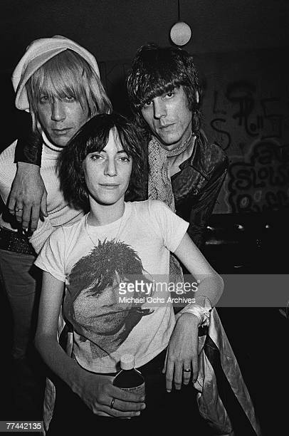 Patti Smith poses with Iggy Pop and James Williamson of The Stooges in November 1974 backstage at the Whisky a Go Go in Los Angeles California