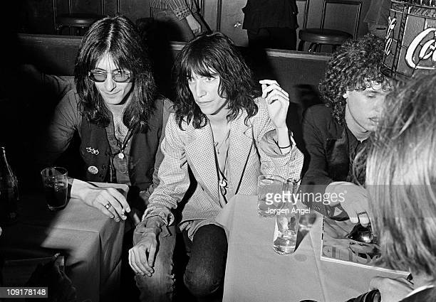 Patti Smith poses with Lenny Kaye and Richard Sohl from the Patti Smith Group in a restaurant in Copenhagen Denmark in May 1975