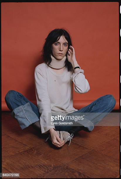 Patti Smith Seated on Floor Wearing a Neck Brace