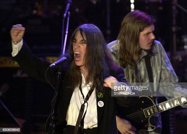 Patti Smith sings 'Power to the People' during induction ceremonies for the Rock and Roll Hall of Fame 06 March 2000 at the WaldorfAstoria Hotel in...