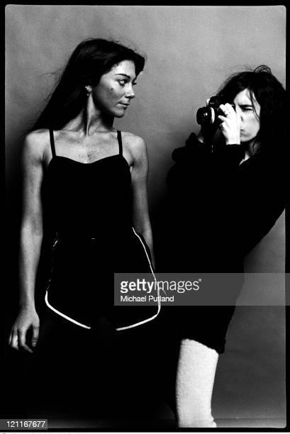 Patti Smith taking a photo of photographer Lynn Goldsmith New York 1978