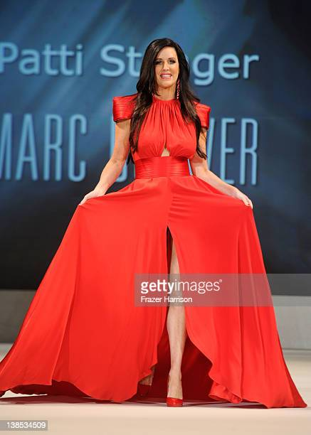 Patti Stanger walks on the runway wearing a Marc Bouwer design at The Heart Truth's Red Dress Collection 2012 Fashion Show at Hammerstein Ballroom on...
