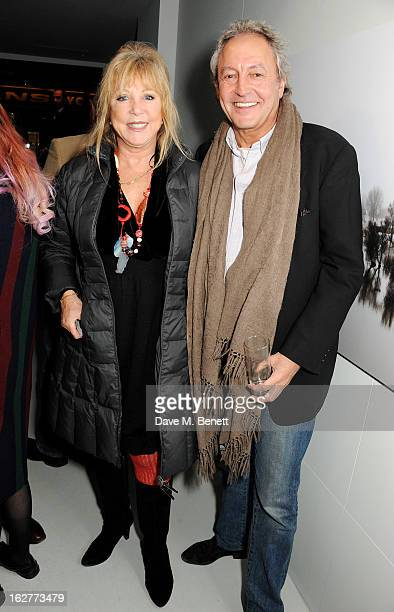 Pattie Boyd and Rod Weston attend a private view of Bill Wyman's new exhibit 'Reworked' at Rook Raven Gallery on February 26 2013 in London England