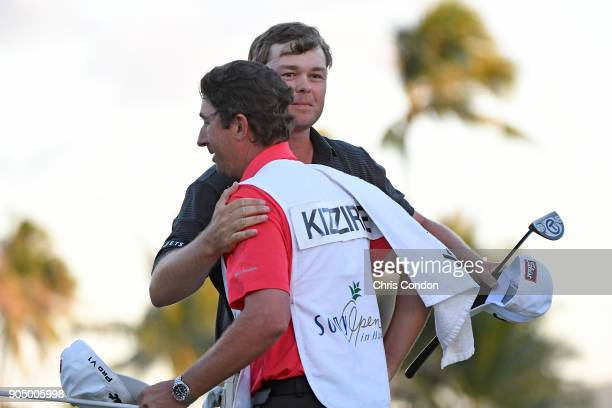 Patton Kizzire hugs his caddie after winning a 6hole playoff at the Sony Open in Hawaii at Waialae Country Club on January 14 2018 in Honolulu Hawaii