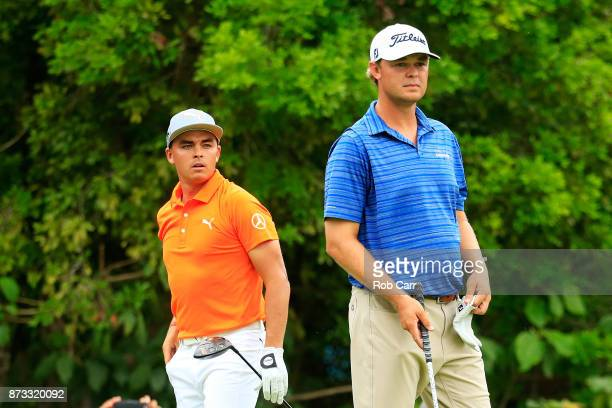 Patton Kizzire of the United States and Rickie Fowler the United States look on from the seventh tee during the final round of the OHL Classic at...