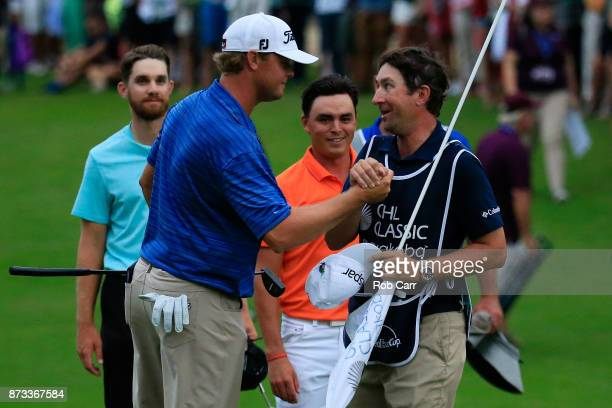 Patton Kizzire of the United States celebrates with caddie Joe Etter on the 18th green after winning during the final round of the OHL Classic at...