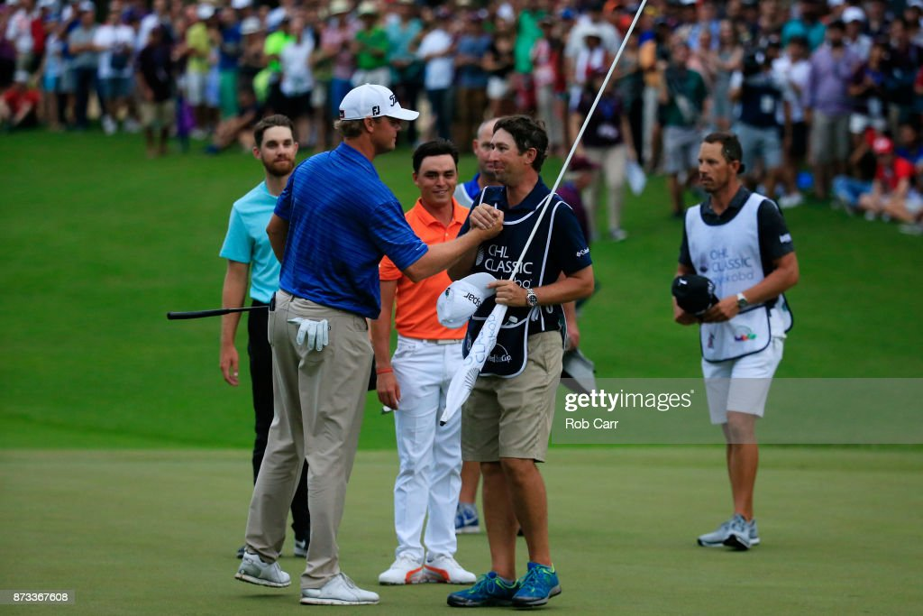 Patton Kizzire of the United States celebrates with caddie Joe Etter on the 18th green after winning during the final round of the OHL Classic at Mayakoba on November 12, 2017 in Playa del Carmen, Mexico.