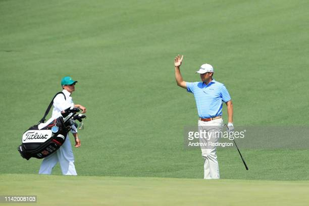Patton Kizzire of the United States celebrates with caddie Phillip Mollica after making an eagle on the second green during the first round of the...