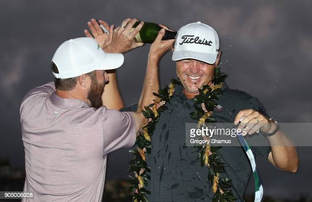 Patton Kizzire of the United States celebrates with Chris Kirk after winning the Sony Open In Hawaii on the sixth playoff hole against James Hahn at...
