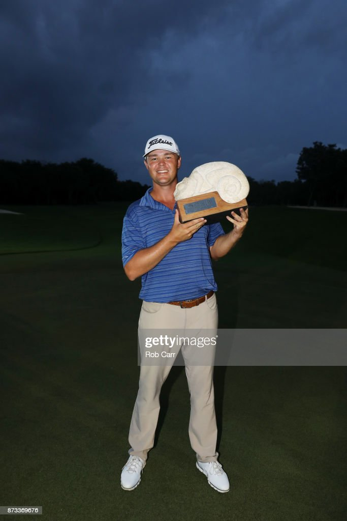 Patton Kizzire of the United States celebrates with the trophy on the 18th green after winning during the final round of the OHL Classic at Mayakoba on November 12, 2017 in Playa del Carmen, Mexico.