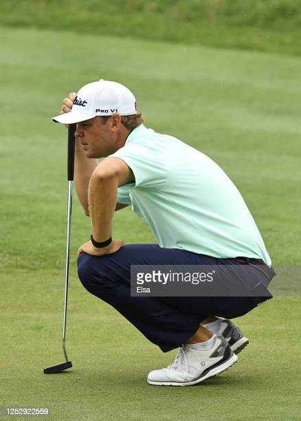 Patton Kizzire of the United States lines up a putt on the 18th green during the third round of the Travelers Championship at TPC River Highlands on...