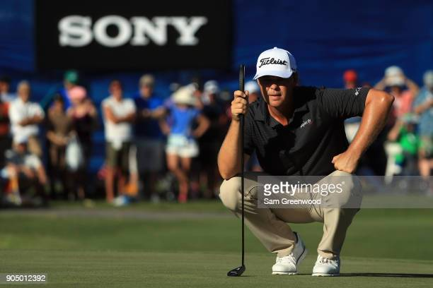 Patton Kizzire of the United States lines up a putt on the 18th green during a playoff against James Hahn of the United States in the final round of...