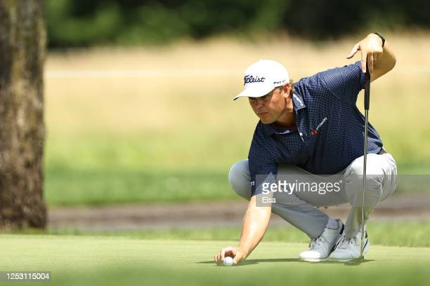 Patton Kizzire of the United States lines up a putt on the fourth green during the final round of the Travelers Championship at TPC River Highlands...