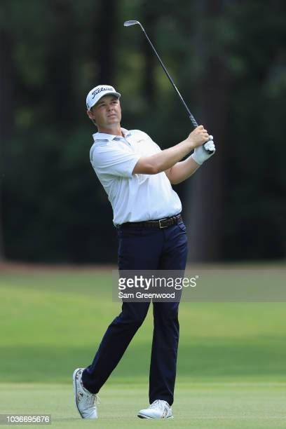 Patton Kizzire of the United States plays a shot on the seventh hole during the first round of the TOUR Championship at East Lake Golf Club on...