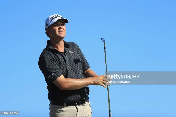 Patton Kizzire of the United States plays his shot from the 17th tee during the final round of the Sony Open In Hawaii at Waialae Country Club on...