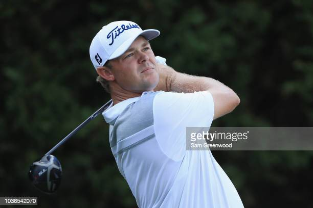 Patton Kizzire of the United States pulls a club from his bag as he prepares to play a shot on the first hole during the first round of the TOUR...