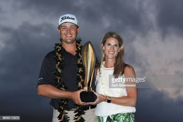 Patton Kizzire of the United States poses with his wife Kari and the trophy after winning the Sony Open In Hawaii on the sixth playoff hole against...