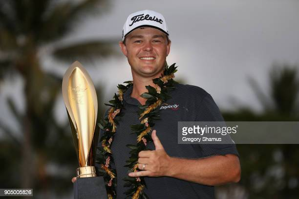 Patton Kizzire of the United States poses with the trophy after winning the Sony Open In Hawaii on the sixth playoff hole against James Hahn at...