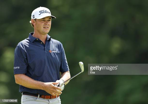 Patton Kizzire of the United States reacts to his shot from the fifth tee during the final round of the Travelers Championship at TPC River Highlands...
