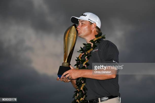 Patton Kizzire poses with the tournament trophy after winning a 6hole playoff at the Sony Open in Hawaii at Waialae Country Club on January 14 2018...