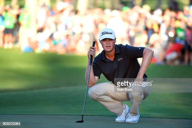 Patton Kizzire studies his putt on the 18th hole during the final round of the Sony Open in Hawaii at Waialae Country Club on January 14 2018 in...
