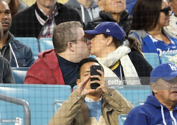 Patton Oswalt and wife Meredith Salenger attend The Los Angeles Dodgers Game at Dodger Stadium on April 20 2018 in Los Angeles California