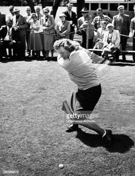 Patty Berg swings at a golf driving demonstration Pebble Beach California June 28 1956
