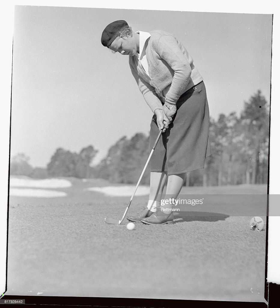 Patty Berg, youthful golf star from Minneapolis, is pictured putting during the Aiken Invitation Four-Ball Round Robin tournament at Highland Park Country Club here. The tournament was won by Kathryn Hemphill and Helen Dettweiler. Miss Berg and Jane Cothran Jameson took runner-up honors.
