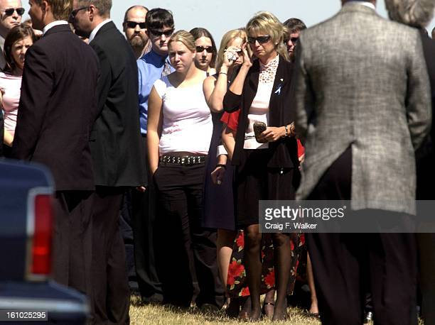 BEATRICE NE SEPTEMBER 10 2004 Patty <cq> Spady watches as the casket of her daughter Samantha Spady is set in place for the burial at Evergreen...