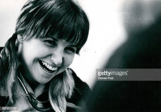 Patty Del Pico a 'visiting nurse' laughs at a joke in the examination room Credit Denver PostInc