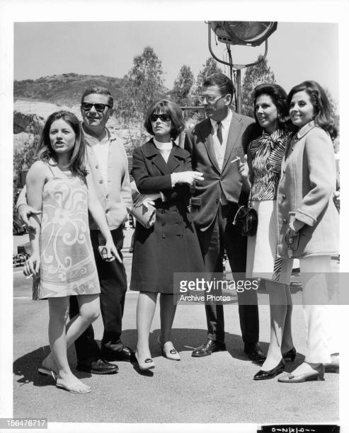 Patty Duke Mark Robson Lee Grant and Barbara Parkins stand together during a break from shooting the film 'Valley Of The Dolls' 1967