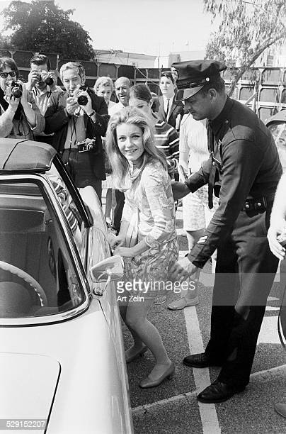 Patty Duke with secuity and paparazzi in the background circa 1970 New York