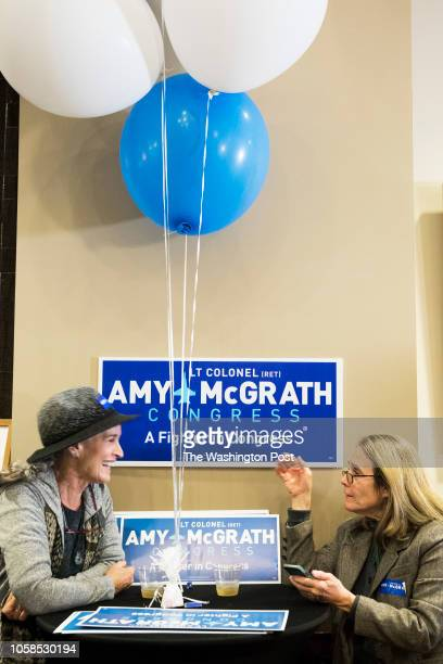 RICHMOND KENTUCKY USA NOVEMBER 6 2018 Patty Gates and Jude Ferring supporters of Democratic Candidate Amy McGrath await election returns at Eastern...