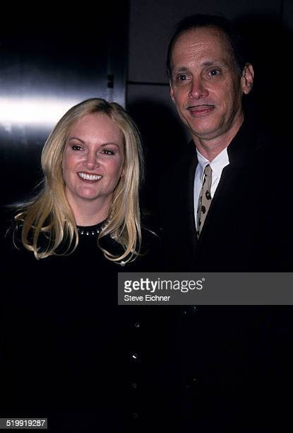 Patty Hearst and John Waters at event, New York, 1990s.